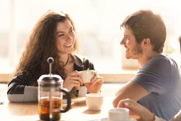 Beautiful woman having cup of coffee with her handsome boyfriend on a date - How to Flirt with a Gemini Man the Right Way