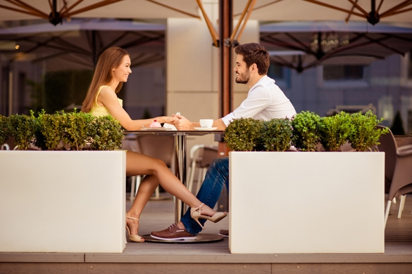 Playful girlfriend is flirting with guy by her leg - How to Flirt with a Gemini Man the Right Way