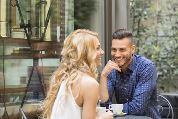 Beautiful couple having coffee on a date - The Gemini Man Romance Guide