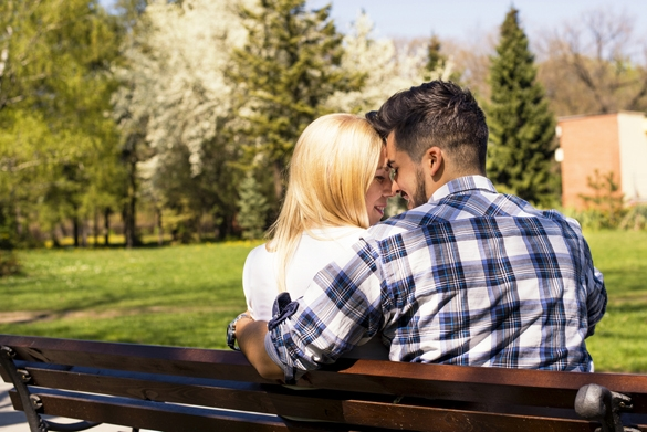 Beautiful loving couple flirting in the park on beautiful sunny day - Signs a Gemini Man Is Falling In Love with You