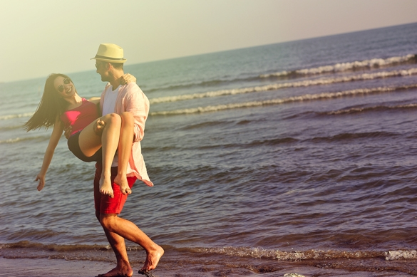 Beautiful young couple in love enjoying and having fun at the beach - How To Get A Gemini Man To Commit To You