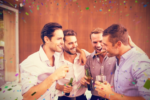Group of young men having drinks against flying colours - How To Get A Gemini Man To Commit To You