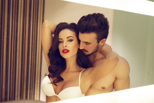 Sexy young couple in mirror at home - The Gemini Man Romance Guide