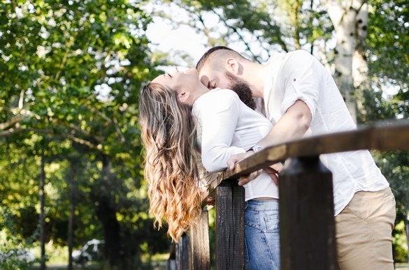 sexy macho man kissing woman breasts in nature - Are Gemini Men Perverts